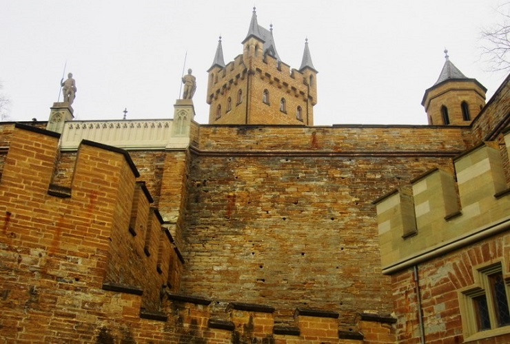 looking up at the castle walls and main tower