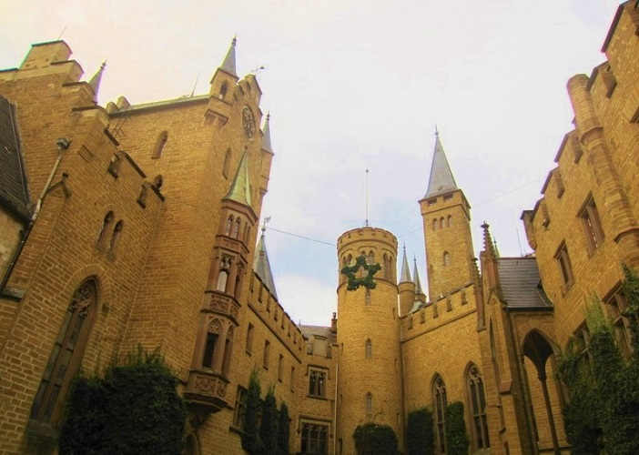 looking up at the castle and towers from the courtyard