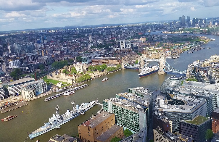 View from the Shard of boat going under Tower Bridge
