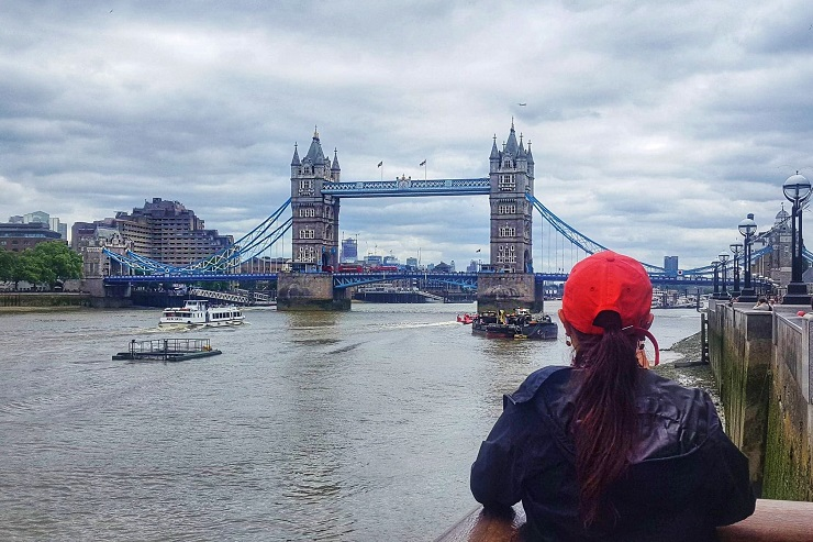 Mel B taking a picture of Facts of Tower Bridge London
