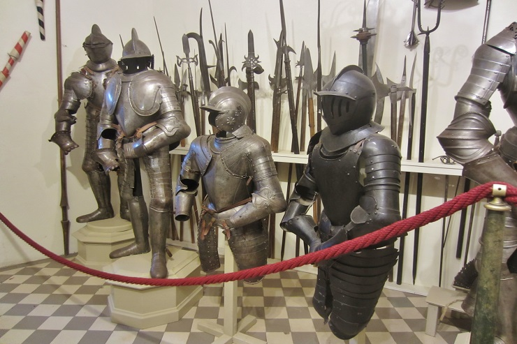knight's armour and weapons on display inside the castle
