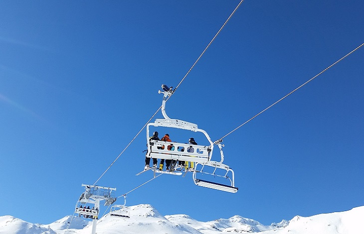 Skiers on the chairlift in Val Thorens Ski Resort, France