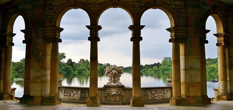 Looking through arched columns over the lake