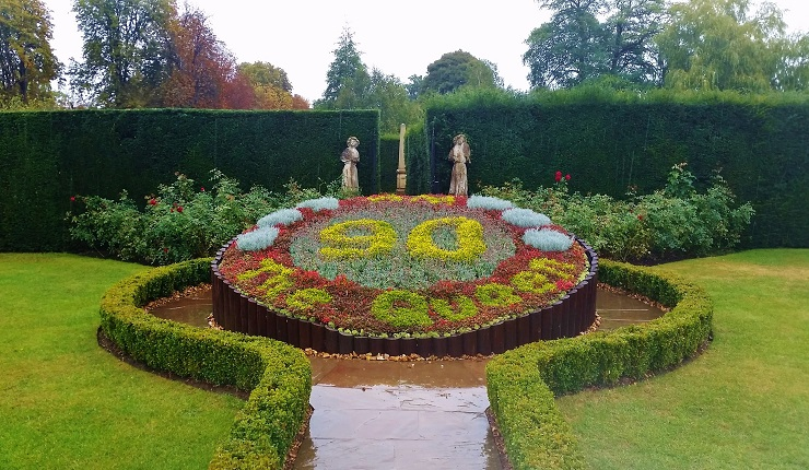Ornamental floral display at the entrance to the hedge maze