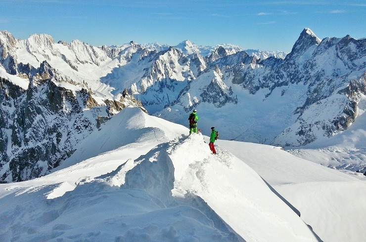 Skiers on ridge in Chamonix France
