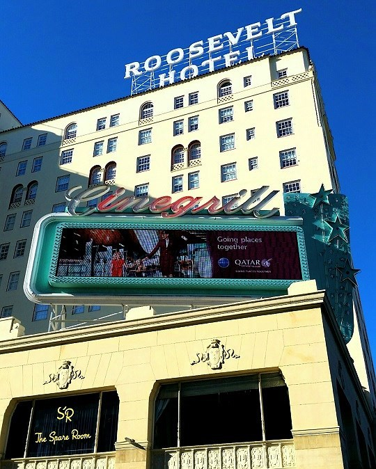 Roosevelt hotel with neon sign on the rooftop - Where to stay in Hollywood