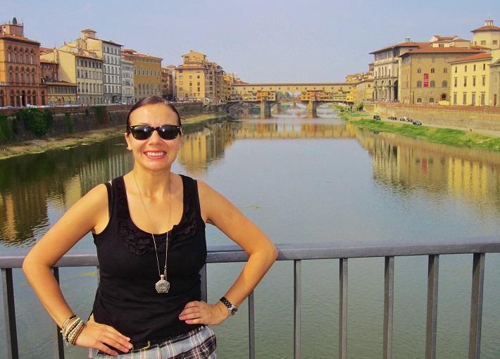 Selfie on a bridge over the Arno with Pnte Vecchio bridge in the background