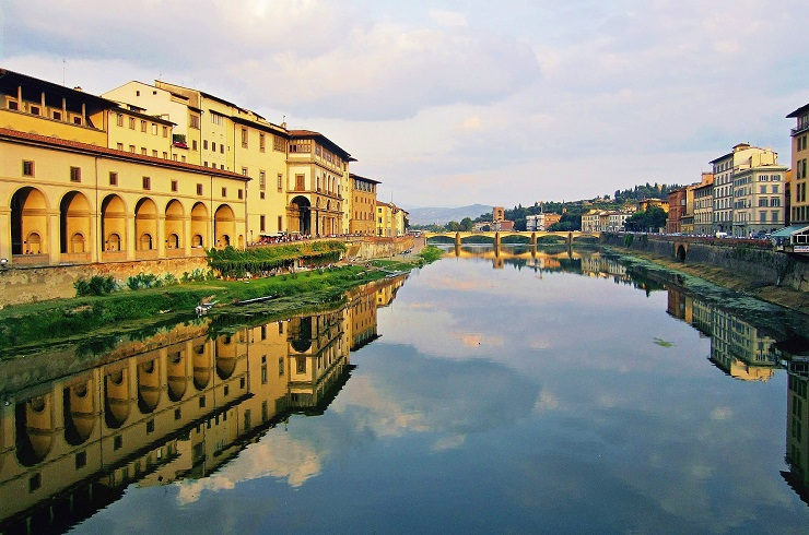 Reflection on the river from Ponte Vecchio Bridge famous bridge in florence