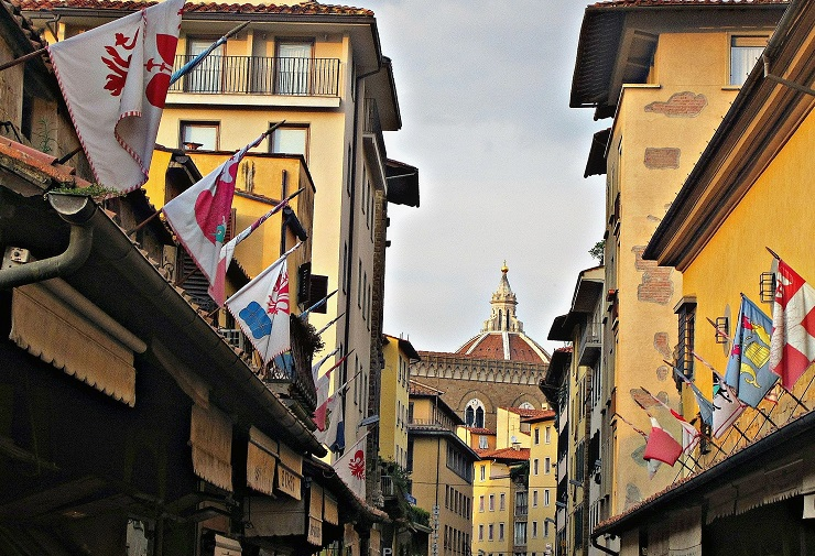 Flags jutting from buildings on Florence street