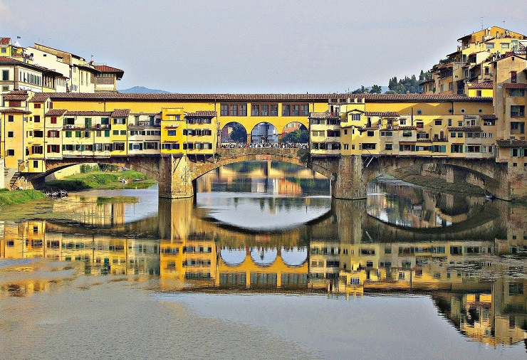 Ponte Vecchio Bridge from middle of river famous bridge in florence