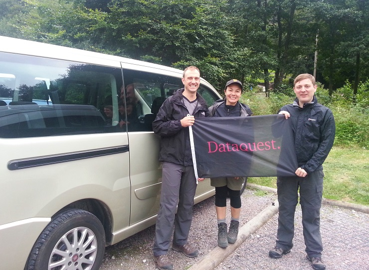 Our group at the start of the three peak challenge displaying our sponsor's flag