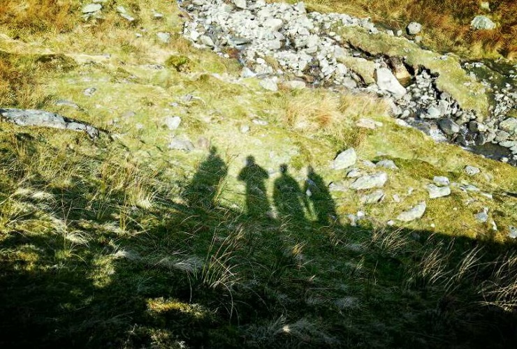 Our groups shadow on the grassy slope of Ben Nevis