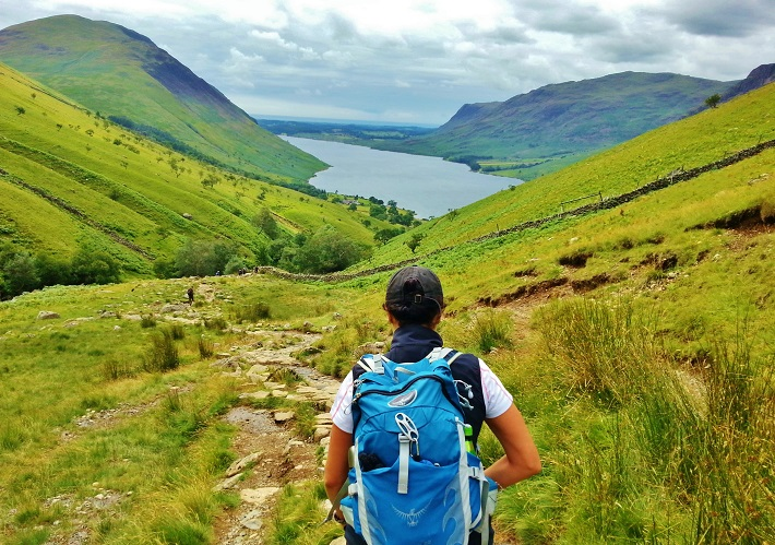 Following Mel B on the way down from Scafell between green hills with Wastwater in the distance