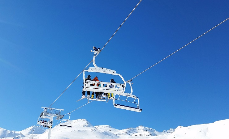 Skiers taking the chairlift to the top of Val Thorens