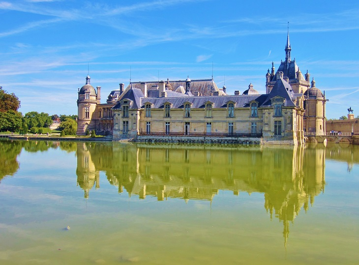Looking over the watercourse to Chateau de Chantilly France