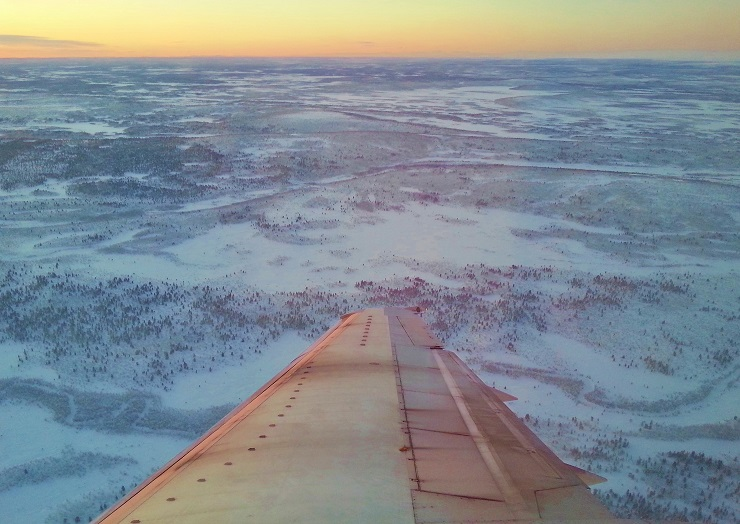 view from plane of Sweden's snow covered landscape