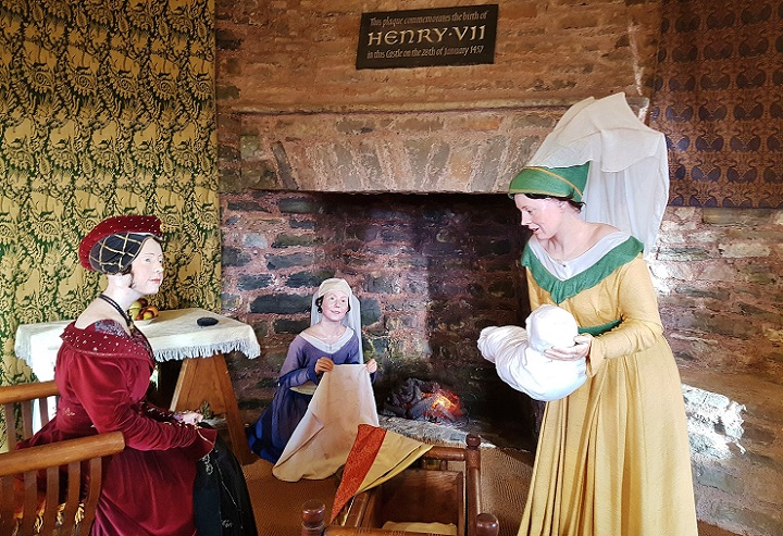 wax dummies of 3 women and a baby in Henry VII birthing room