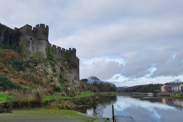 Wall of Pembroke Castle and lake