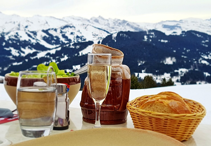A glass of Prosecco during lunch with the Alps in the background