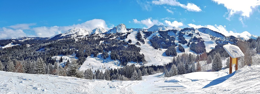 Panoramic view of the snow covered ski slopes of Les Gets France