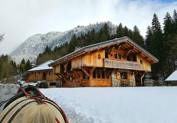 view of chalet from horse drawn carriage outdoor winter activities in morzine