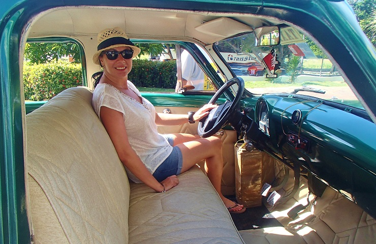 Mel in the drivers seat of vintage car