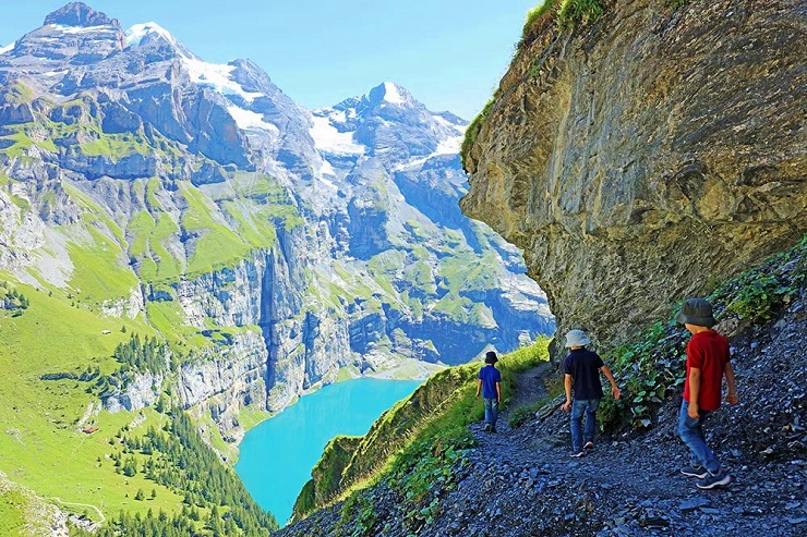 Travel Bloggers Kids hiking around Oeschinen Lake Switzerland
