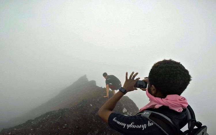 Hiking along fog covered ridge