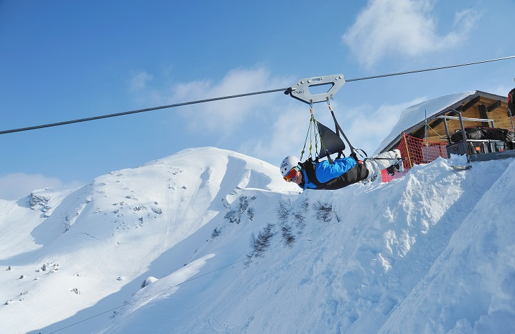 Ziplining across the snow covered mountains