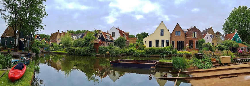Panoramic view of houses on the canal