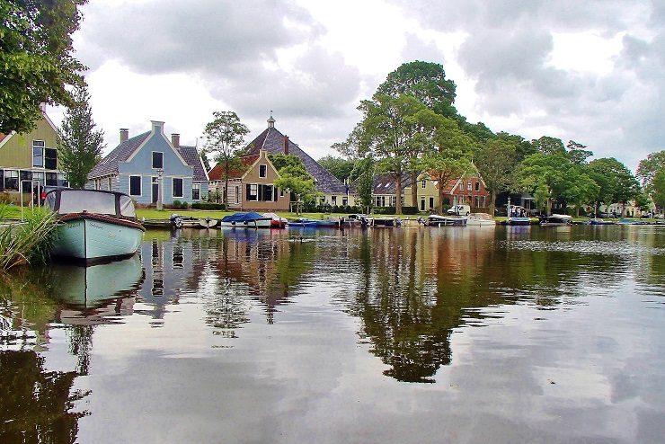 Traditional Dutch houses on the waterfront - Broek in Waterland Day trip out of the Netherlands