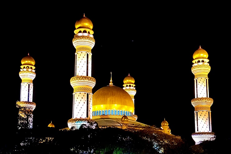 Golden domes of Jame asr Hassani Bolkiah Mosque at night