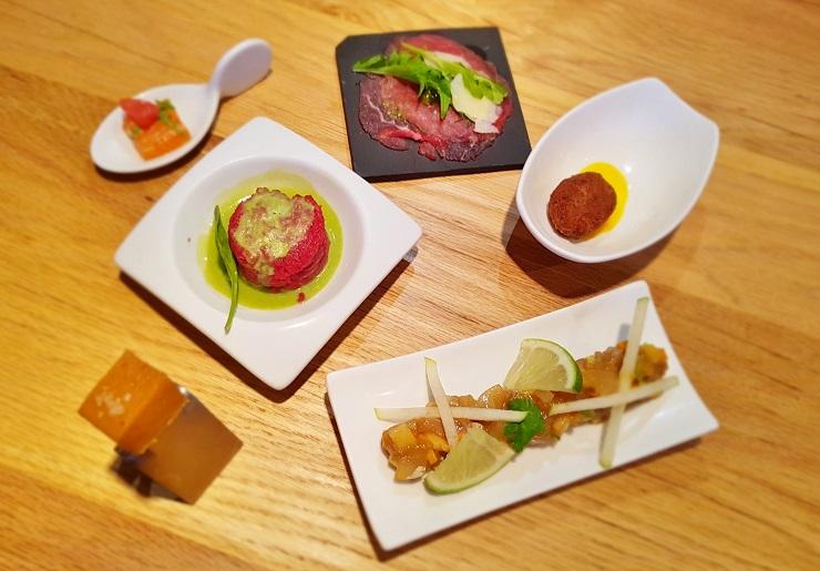 Dinner of small plates of elegant food
