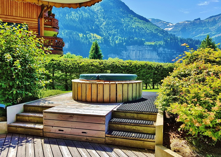 outdoor hot tub with views of the Swiss Alps