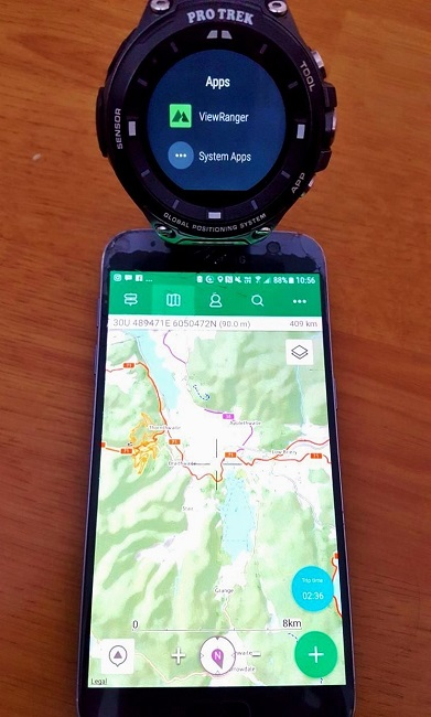 Casio ProTrek watch and smartphone displaying hiking route map