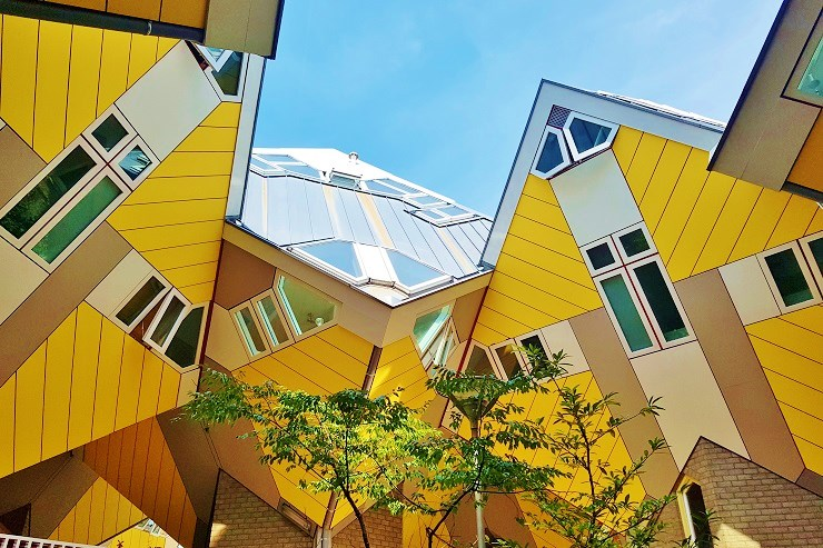looking up at the yellow cube houses