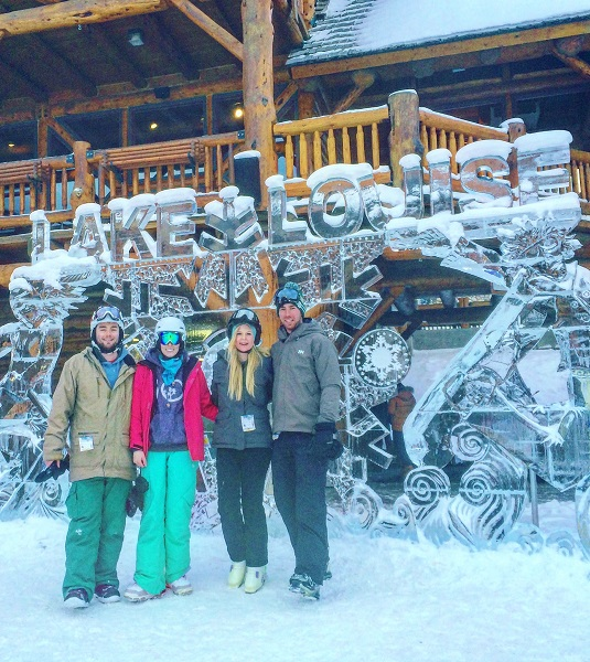 Group photo in front of Lake Louise ice carving