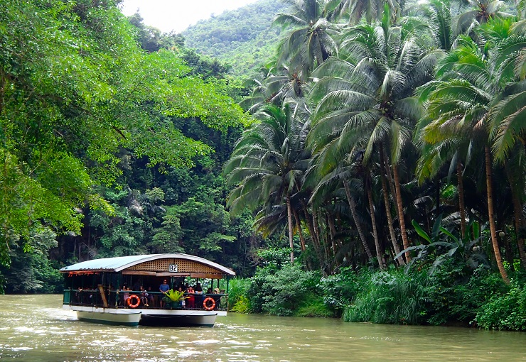 Local boat winding its way down river through the jungle