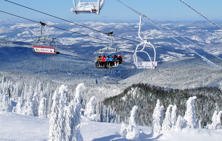 Skiers riding the chairlift in Jahorina ski resort