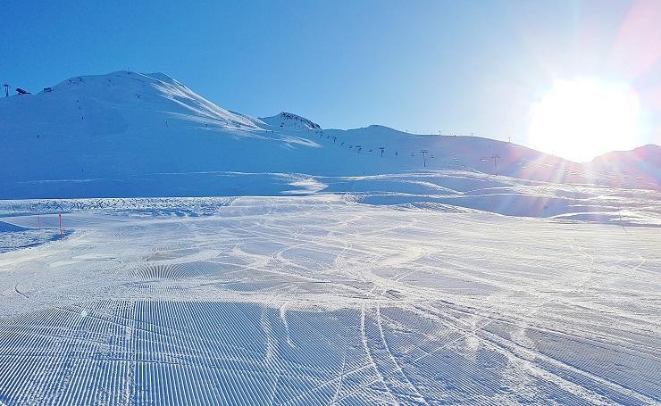 Groomed ski runs on a bright sunny day