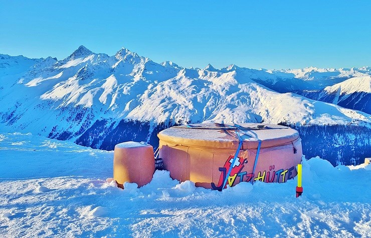 A hot tub in the middle of the snow fields