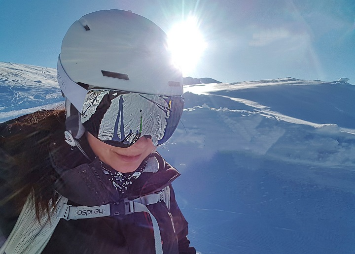 Checking the reflection in Mel B's goggles on a sunny ski slope davos switzerland ski resort