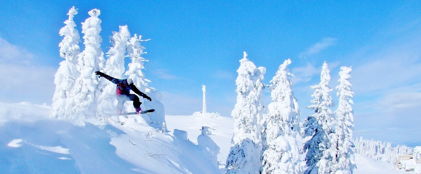 Snowboarder launches off jump in Jahorina Ski Resort Sarajevo Bosnia