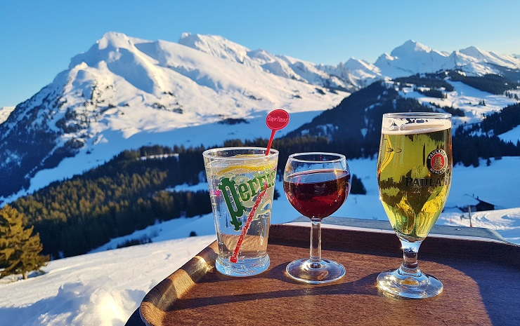 Various drinks with snow capped mountains in the background