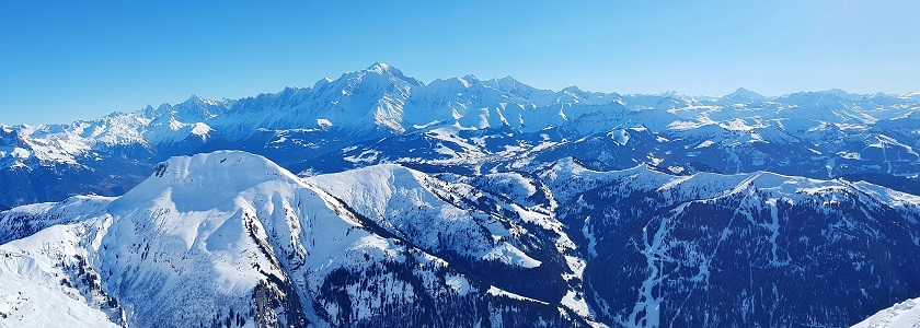 A winter view of the snow capped Alps from La Clusaz ski resort