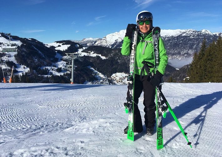 Mel B dressed in green to match her Head Skis