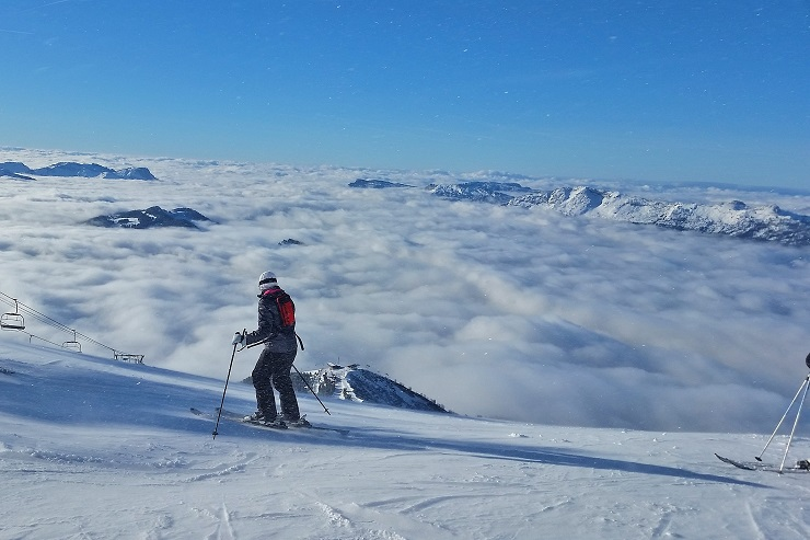 Skier looking over the clouds in La Clusaz ski resort