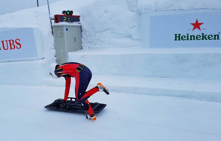 Chinese Olympic Athlete taking off for a skeleton training run