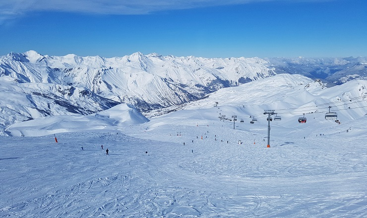 View of the snow covered French Alps from Les Menuires ski run