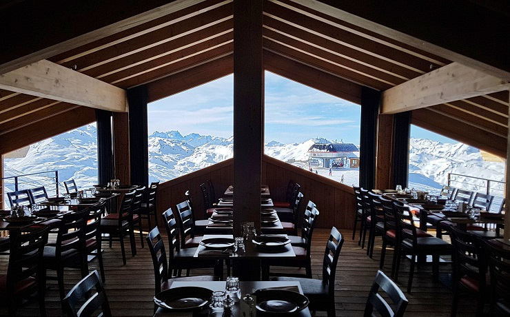 Dining area of BoucheaOreille with views of the Alps